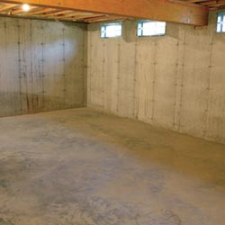 A cleaned out basement in Henrietta, shown before remodeling has begun