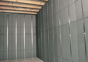 SilverGlo™ insulation and metal studs making up our Basement to Beautiful™ panels.  Installed in Penfield.